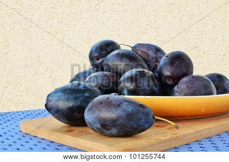 Damson Plums On Yellow Plate