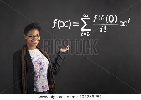 African Woman Holding Hand Out With Mathematical Equation On Blackboard Background