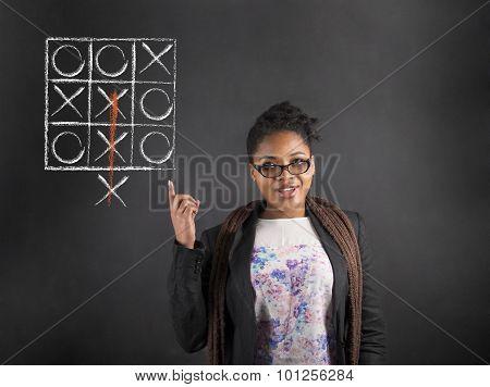 African Woman Good Idea Tic Tac Toe On Blackboard Background
