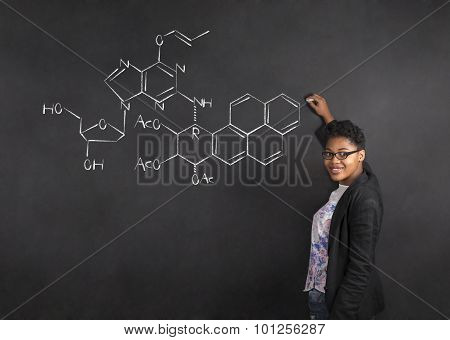 African American Woman Teacher Writing Science On Chalk Black Board Background