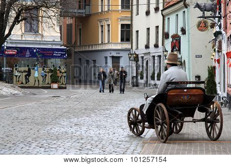 Riga, Latvia - March 18, 2012: Meistaru Street In Old Riga, Latvia. Old Wagon Is Used Like An Advert