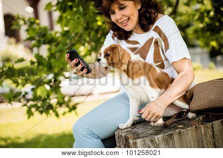 Woman, dog and mobile phone