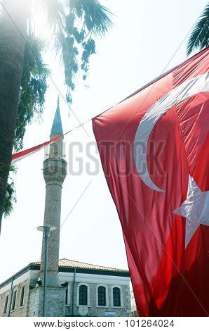 Big Turkish Flag with a mosque behind