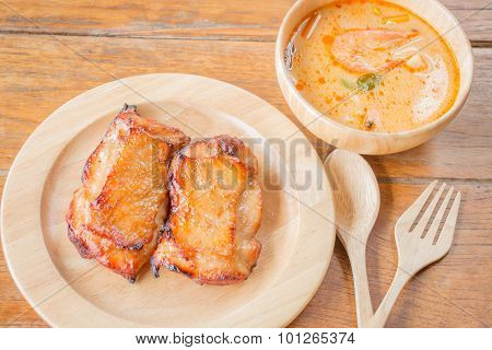 Chicken Steak And Spicy Soup On Wooden Table