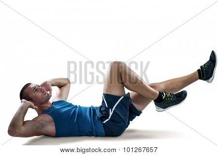 Full length of man doing tummy crunches against white black
