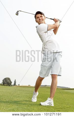 Golfer admiring the shot he has just played