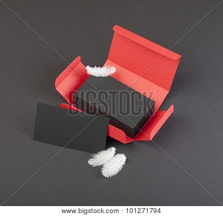 Black Business Cards In The Red Box.