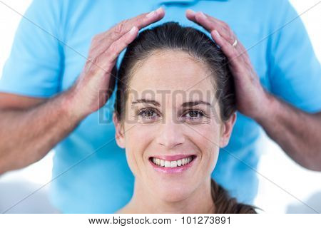 Portrait of smiling woman getting reiki treatment at home