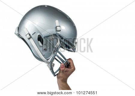 Cropped image of American football player handing his sliver helmet on white background