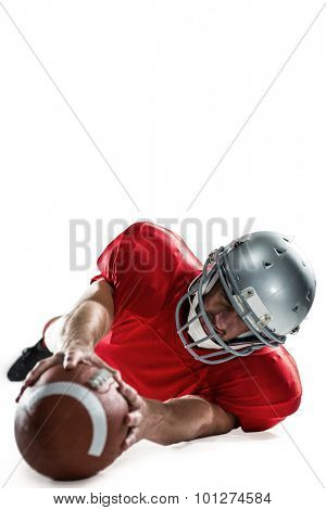 Sportsman struggling to catch the ball against white background