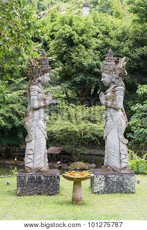 Traditional Stone Sculpture In Garden . Island Bali, Ubud, Indonesia