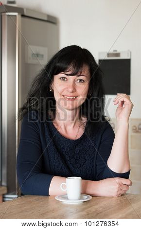 Happy Woman In The Kitchen