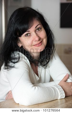 Portrai Of Smiling Woman At Kitchen