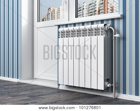 White Radiator With Thermostat In The Apartment