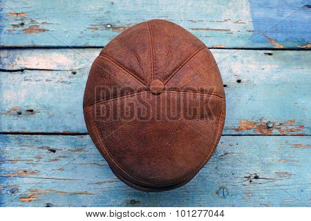 leather headgear  on a wooden wall