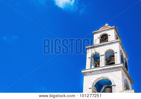 View on church tower with bell, Greece