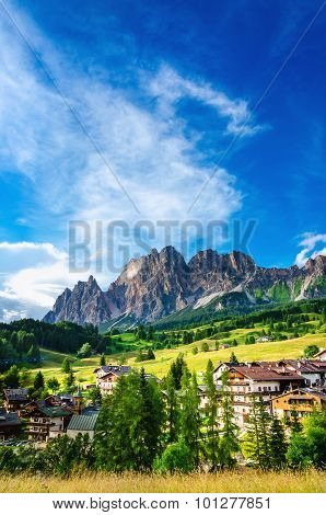 Cristallo Mountains with alpine village, Italy