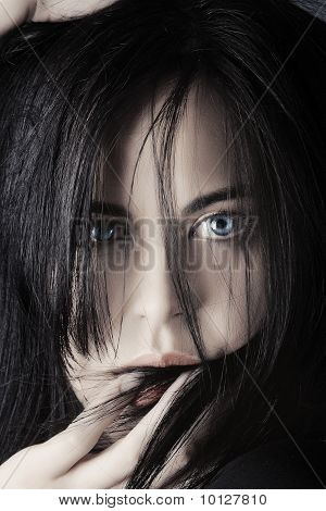 Young Woman Touching Her Lips