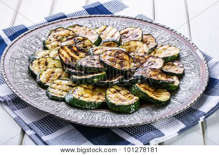 Zucchini.  Slices of grilled zucchini on a plate. Vegetarian - Mediterranean cuisi