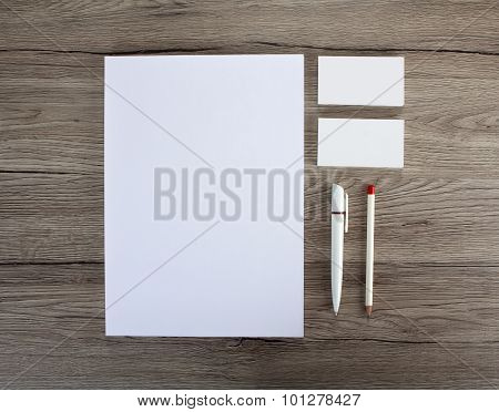 Blank Stationery On Wooden Background. Consist Of Business Cards, A4 Letterheads, Pen And Pencil?