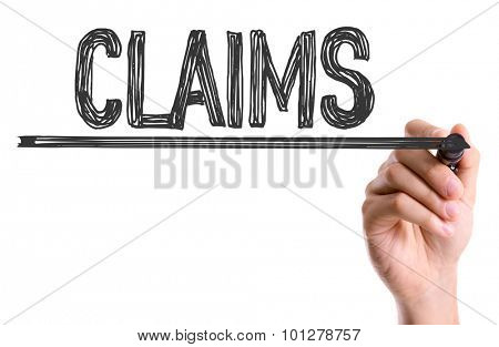 Hand with marker writing the word Claims