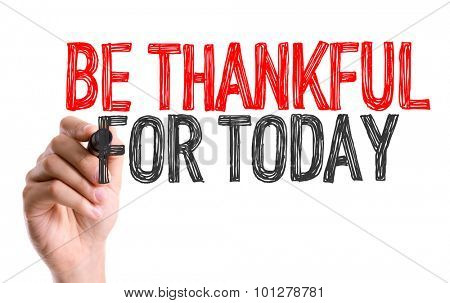 Hand with marker writing the text Be Thankful For Today