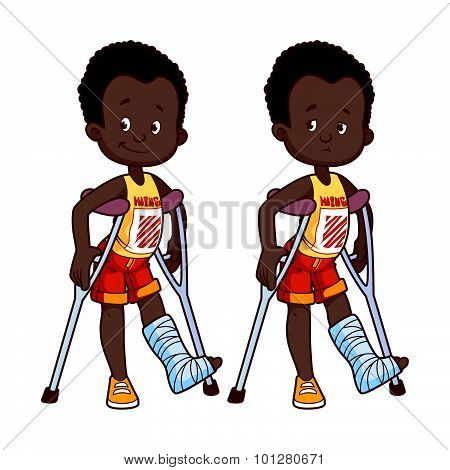 Cheerful And Sad African American Boy With A Broken Leg In A Cast