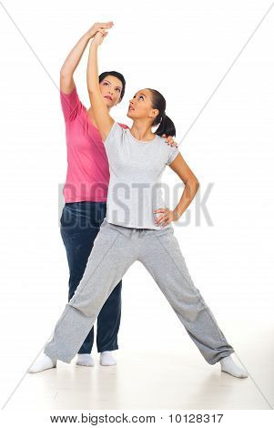 Young Woman With Personal Trainer