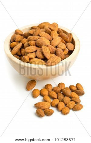 Cracked And Shelled Almond Kernels In Wooden Bowl