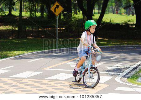 Boy Practice Biking On The Road