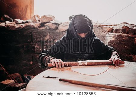 Old Arab Woman Prepares Bread