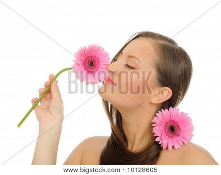 Beautiful Woman With Pure Healthy Skin And Long Hair With 2 Pink Flowers. Isolated On White Backgrou
