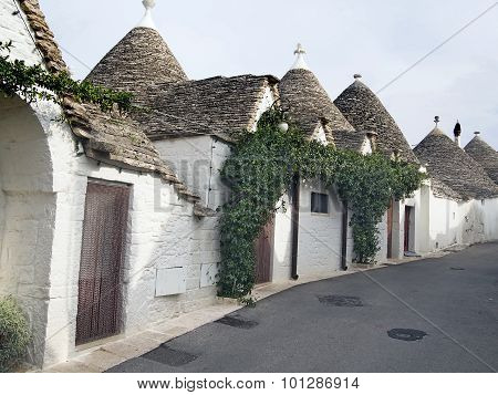 White Trulli Of Alberobellowith Roofs Cone-shaped In Puglia