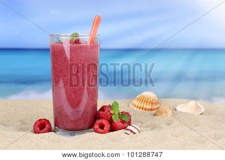 Raspberry Smoothie Fruit Juice Cocktail With Raspberries Fruits On The Beach