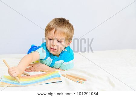 little boy drawing at home
