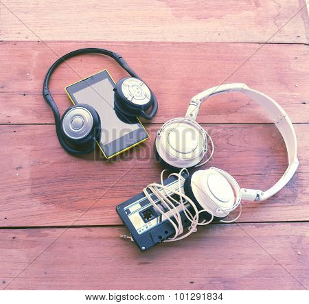 The Concept Of Difference Technology ,picture Of Smart Phone Playing Online Radio And Old Cassette T