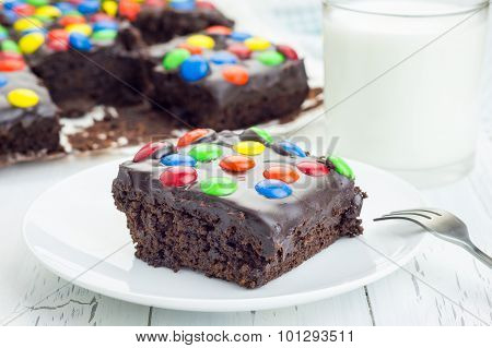 Homemade Brownies With Chocolate Ganache And Colorful Candies