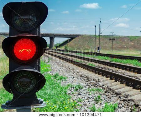 red semaphore near railway. soft focus