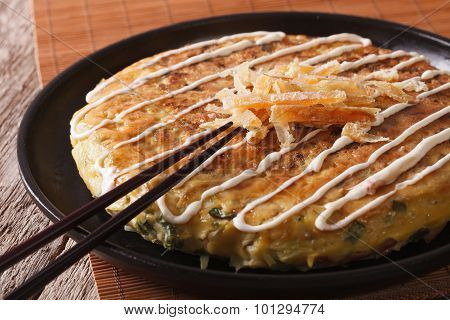 Japanese Pizza: Okonomiyaki On A Plate And Chopsticks. Horizontal