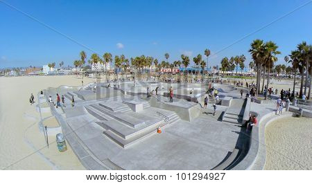 LOS ANGELES - OCT 19, 2014: Many young people get fun on Venice Beach Skate Park at sunny day. Aerial view. Skatepark total area is 16000 sq.ft.