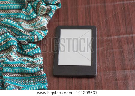 Background Tied with blue sweater with ornaments Wooden table and tablet