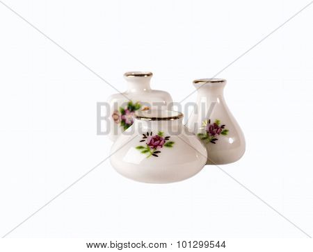 Three white porcelain flower vase on white