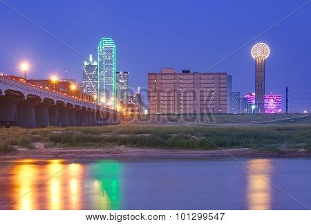 Downtown Dallas, Texas Skyline At Night Reflecting In Trinity River