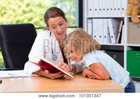 Pediatrician In White Lab Coat And The Little Patient