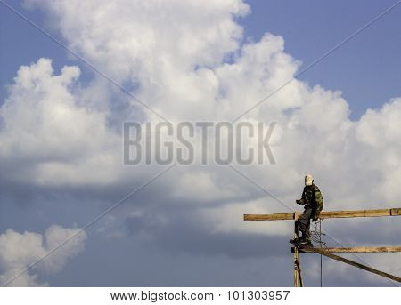 Carpenter Of Thailand Climbing On Roof Top At The Construction Site