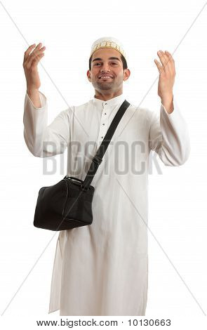Ethnic Man With Arms Raised In Praise