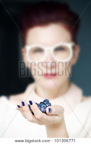 Woman's Hand Full Of Blueberries