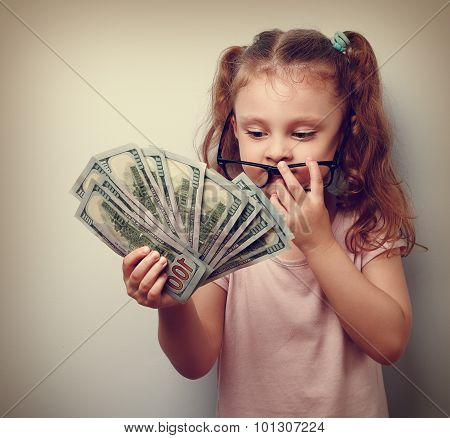 Cute Business Kid Girl Holding Money And Counting The Revenue. Vintage Portrait