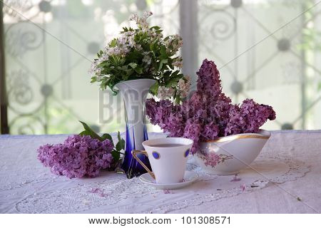 Still-life About A Lilac And A Cup Of Tea