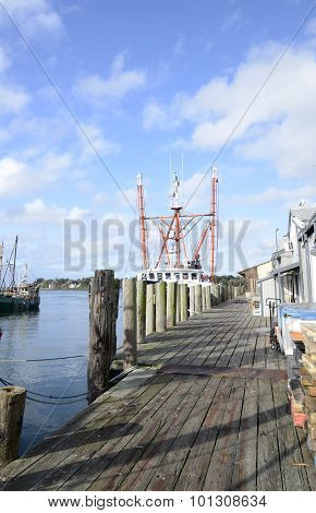 Long Wood Dock By A Commercial Pier